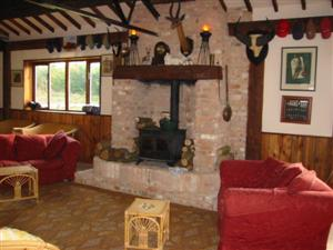 Our Old Barn, with log burning stove!